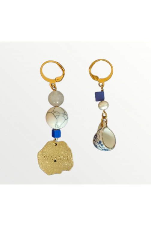 Asymetrical earrings with...