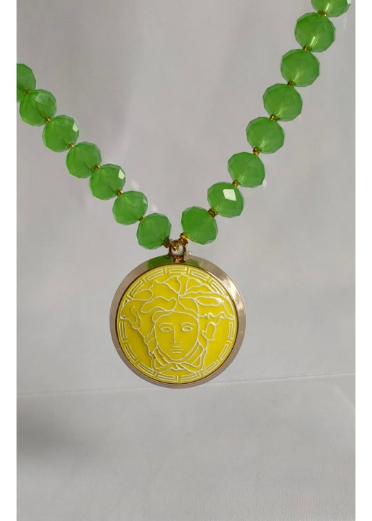 Green necklace with upcycled Versace pendant