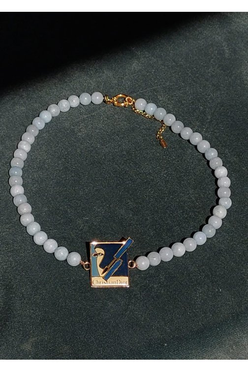 Light blue necklace with...